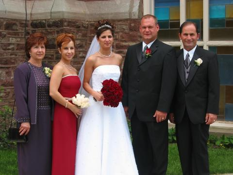 Bride, groom, bride's parents and sister